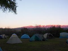Tents with the Sierra del Carmens in back ground. Sierra= Mountains